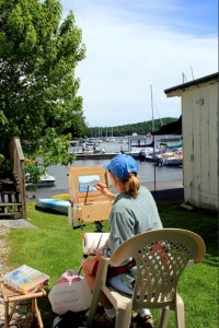 Painting boats in Sunapee Harbor